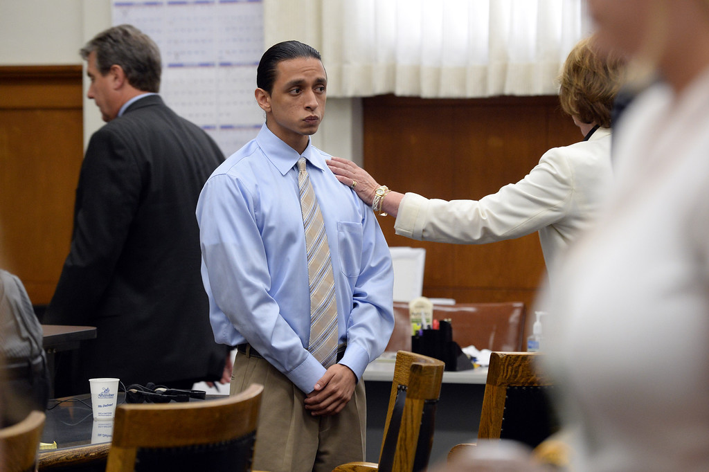 . Defendant Jose Montano is touched by his attorney Jane Elliot as jurors enter the courtroom at the Wakefield-Taylor courthouse in Martinez, Calif., on Thursday, July 18, 2013. Two separate verdicts were read in the Richmond High gang rape trials Marcelles Peter and Jose Montano with Judge Barbara Zuniga presiding. Juries in both cases brought back guilty verdicts. (Dan Honda/Bay Area News Group)
