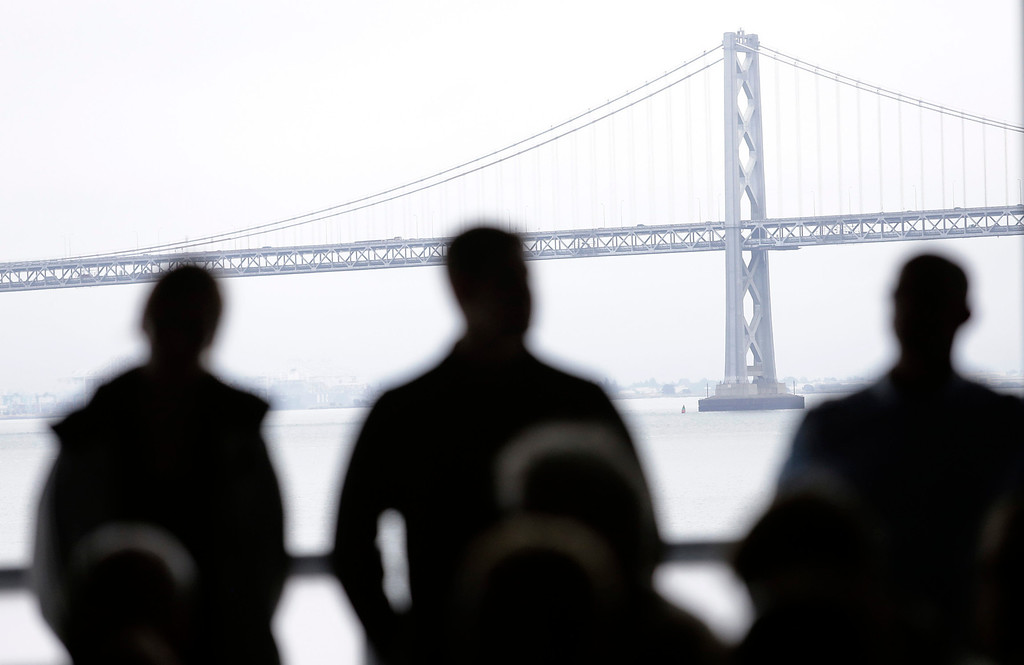 ". The Bay Bridge is in the background of a news conference regarding the  Artemis Racing Team catamaran that capsized Thursday in San Francisco, Calif. on Friday, May 10, 2013. Two-time Olympic medalist, Andrew ""Bart\"" Simpson was killed yesterday afternoon when the Artemis Racing team\'s 72-foot catamaran capsized during a practice run for America\'s Cup in the San Francisco Bay. Simpson was trapped beneath the boat and died after efforts to revive him failed.  (Gary Reyes/ Bay Area News Group)"