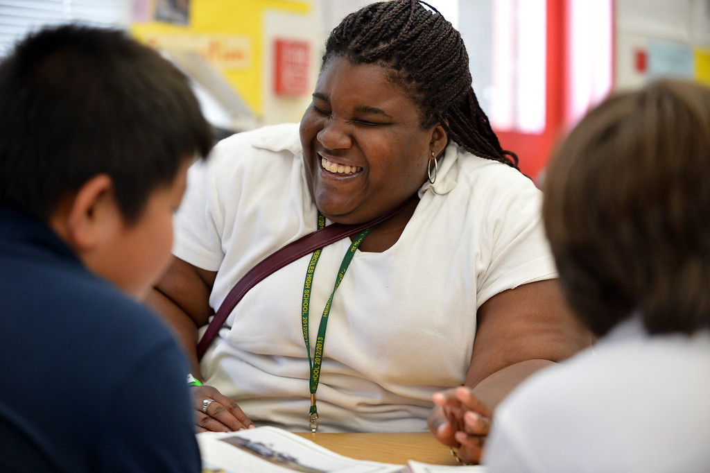 . Hercules High School senior Camille Winfield, who is blind, laughs as she works with third graders on a reading exercise in Sarah Creeley\'s classroom at Hanna Ranch Elementary School in Hercules, Calif. on Thursday, May 30, 2013.  (Kristopher Skinner/Bay Area News Group)