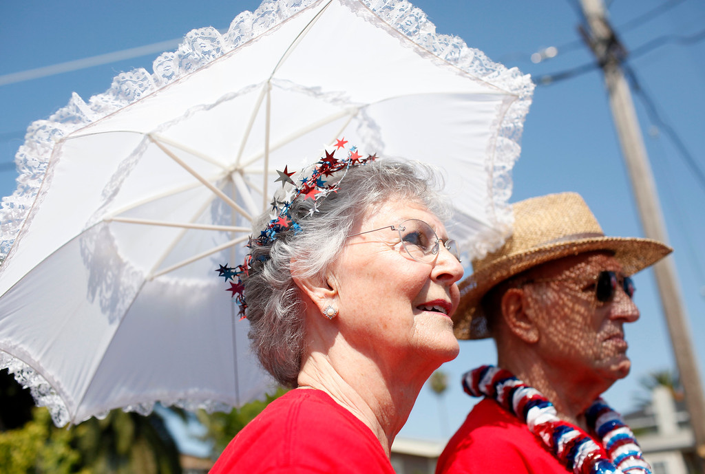 . Amrette and Jerry Butler, with the Daughters of the American Revolution, wait their turn to march in Redwood City\'s 75th annual Fourth of July Parade on Thursday, July 4, 2013.. (Kirstina Sangsahachart/ Daily News)