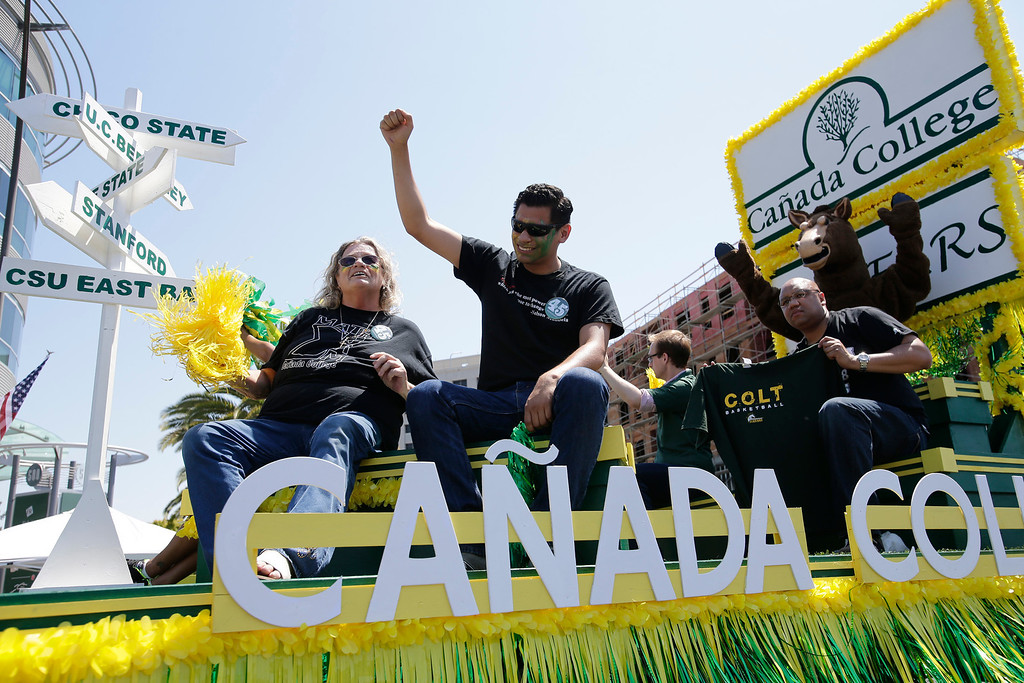 . The Canada College float passes through Arguello St. during the annual Fourth of July parade in Redwood City, Calif. on Thursday, July 4, 2013. Considered the largest Independence Day parade in Northern California, it is celebrating its 75th year. (Gary Reyes/Bay Area News Group)