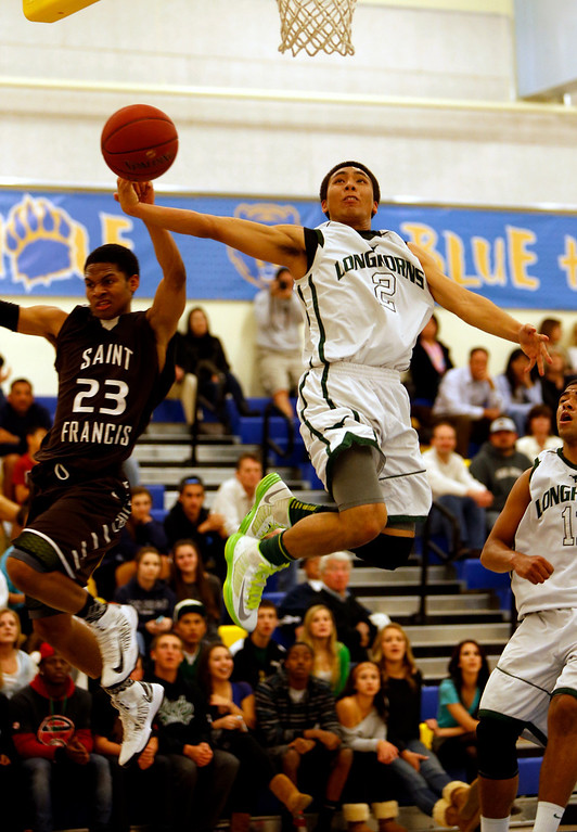 . Leigh High School\'s Kimo Francisco (2) loses control of the ball while taking a shot against St. Francis High School\'s Khalil Johnson (23) in the third period for the CCS Division II Boys Basketball semifinals at Santa Clara High School in Santa Clara, Calif., on Tuesday, Feb. 26, 2013.  St. Francis High School won 69-55.  (Nhat V. Meyer/Staff)