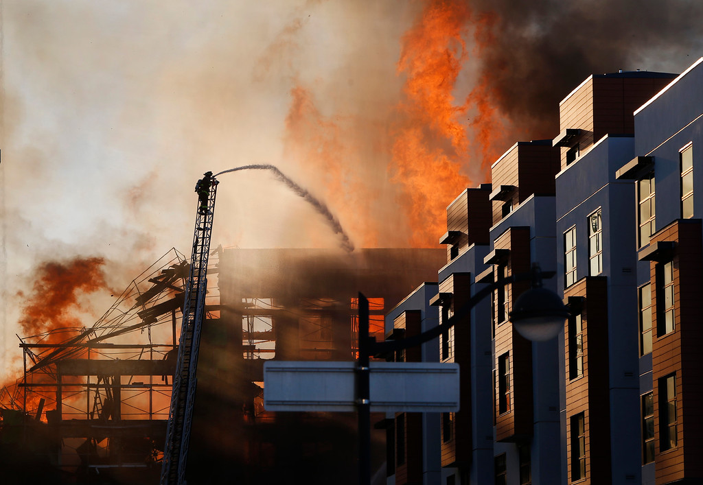 . Firefighters battle a massive blaze at a multi-story residential building under construction in the Mission Bay neighborhood of San Francisco, Calif., Tuesday evening, March 11, 2014. (Karl Mondon/Bay Area News Group)