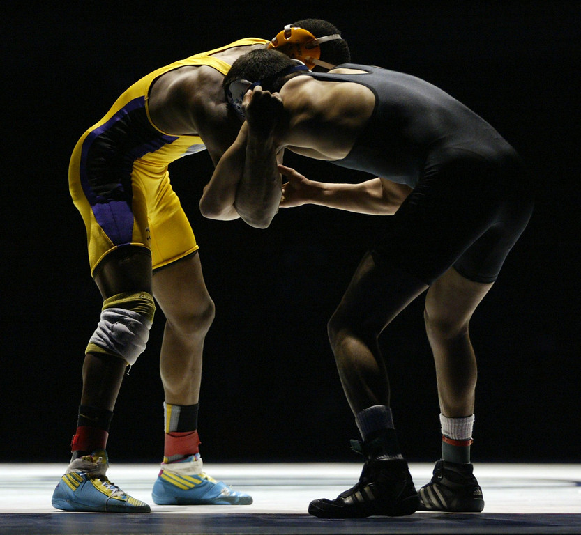 . Riodan\'s Elijah Davis, left, wrestles against  Gilroy\'s Nikko Villareal in the 138-pound championship match during the California Interscholastic Federation wrestling championships in Bakersfield, Calif., on Saturday, March 2, 2013. Villareal would go onto win 3-1. (Anda Chu/Staff)