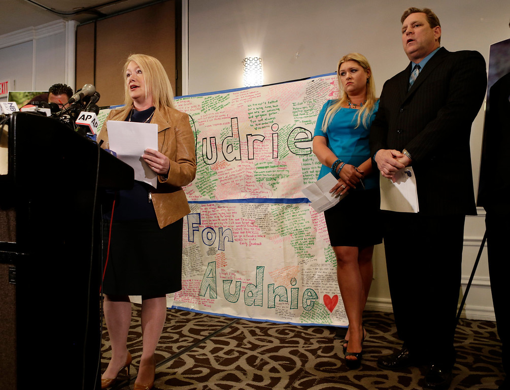 . Sheila Pott speaks in public for the first time about the tragic death of her daughter, Audrie Pott, at a news conference in San Jose, Calif., on Monday, April 15, 2013.  At right is Audrie\'s stepmother Lisa Pott, and father Larry Pott. Saratoga High School student, Audrie 15, committed suicide last September following an alleged sexual assault by three 16-year-old classmates. Photos of the assault were shared publicly prompting her to take her own life eight days later. (Gary Reyes/Bay Area News Group)