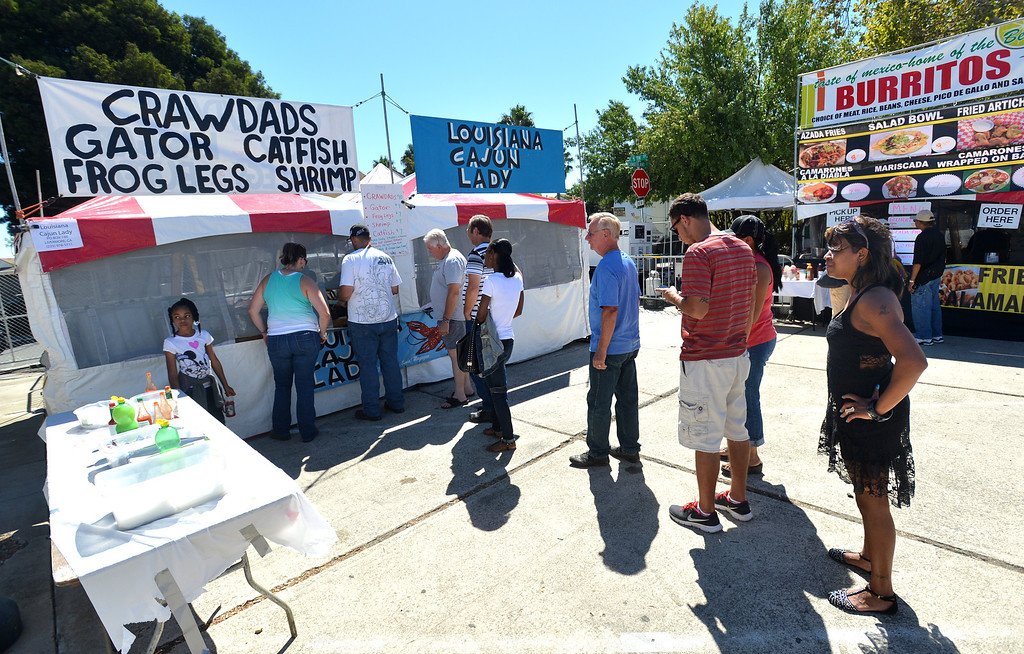 . A long line of customers wait for seafood at the Cajun Lady at the 29th annual Pittsburg Seafood and Music Festival in the city\'s historic Old Town in Pittsburg, Calif., on Saturday, Sept. 7, 2013. (Dan Rosenstrauch/Bay Area News Group)