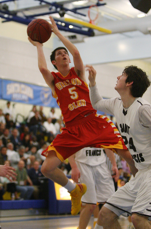 . Willow Glen\'s Mikey Riley shoots on St. Francis\' Eric Morgan in the fourth quarter during the CCS Division II boys basketball finals at Santa Clara High School in Santa Clara, Calif. on Friday, March 1, 2013. The Saint Francis Lancers beat the Willow Glen Rams, 56-46. (Jim Gensheimer/Staff)