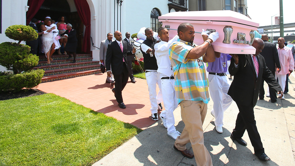 . Pallbearers carry the casket of Alaysha Carradine, 8, out of the McNary-Williams-Jackson Mortuary on Tuesday, July 30, 2013 in Oakland, Calif.  Carradine was shot and killed during a sleepover at a friend\'s house in the 3400 block of Wilson Avenue earlier this month in Oakland.   (Aric Crabb/Bay Area News Group)