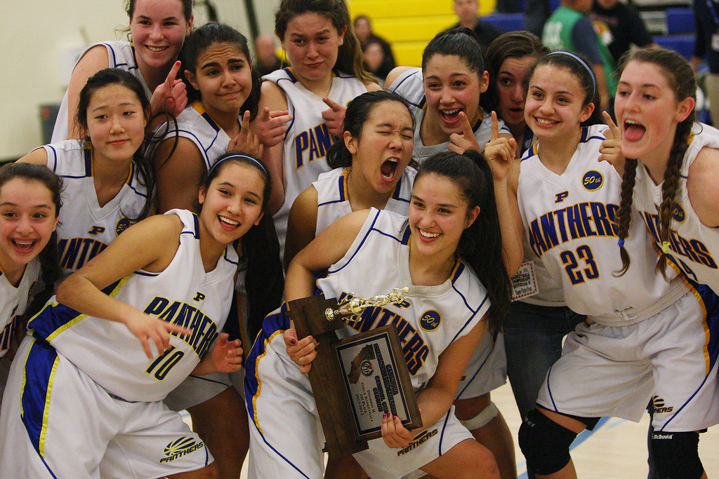 . Courtney Danna holds the CCS trophy as Presentation poses for a team photo after the game during the CCS Division II girls basketball finals at Santa Clara High School in Santa Clara, Calif. on Friday, March 1, 2013. The Presentation Panthers beat the Woodside Wildcats, 49-34. (Jim Gensheimer/Staff)