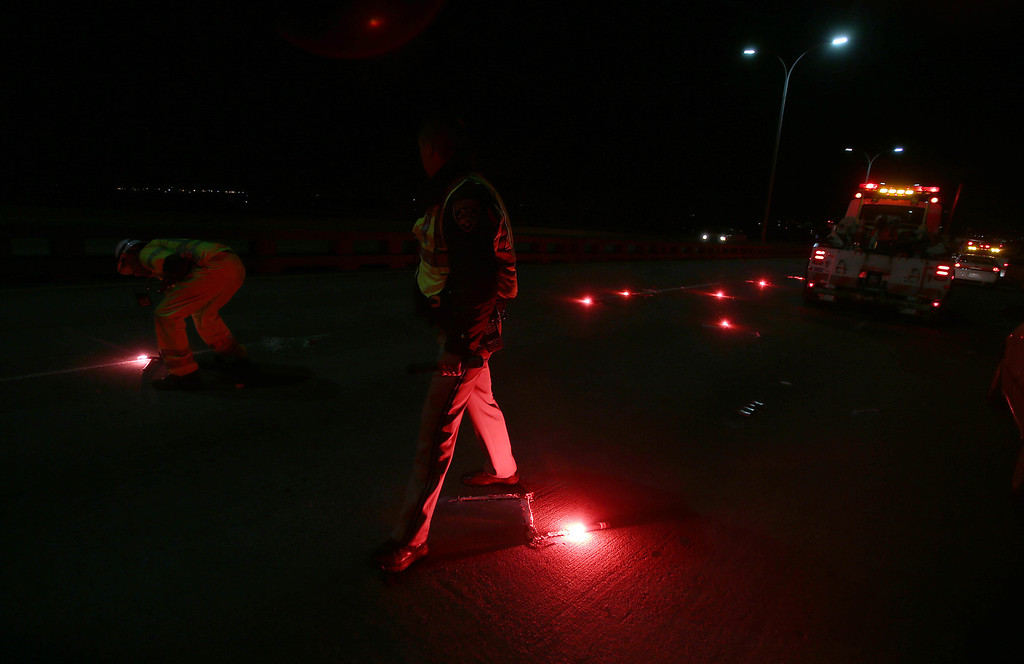 . California Highway Patrol light flares as they investigate the scene of a limousine fire on the westbound side of the San Mateo-Hayward bridge in Foster City, Calif., on Saturday, May 4, 2013. Five women died when they were trapped in the limo that caught fire as they were traveling. Four women and the driver were able to escape.(Jane Tyska/Bay Area News Group)