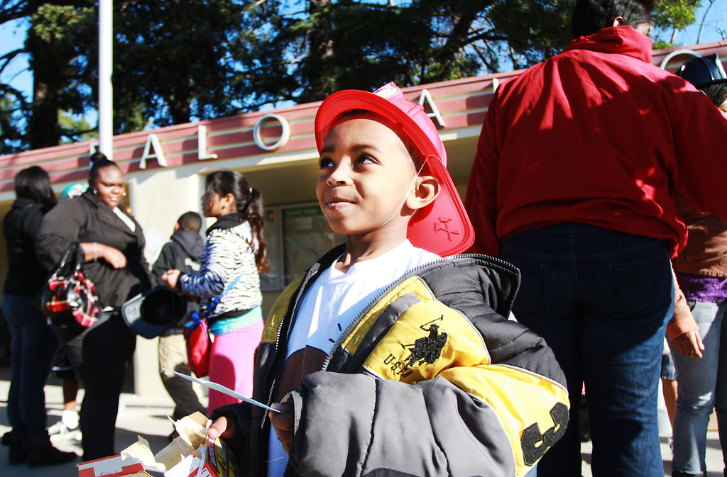 . Joshua Waller, 6, holds his ticket while waiting for the Freedom Train at the University Avenue train station in Palo Alto, Calif., on Monday, Jan. 21, 2013. The Dr. Martin Luther King, Jr. Association of Santa Clara Valley sponsored the event. The train left San Jose and picked up riders on the way to a march and rally in San Francisco. (Kirstina Sangsahachart/Staff)