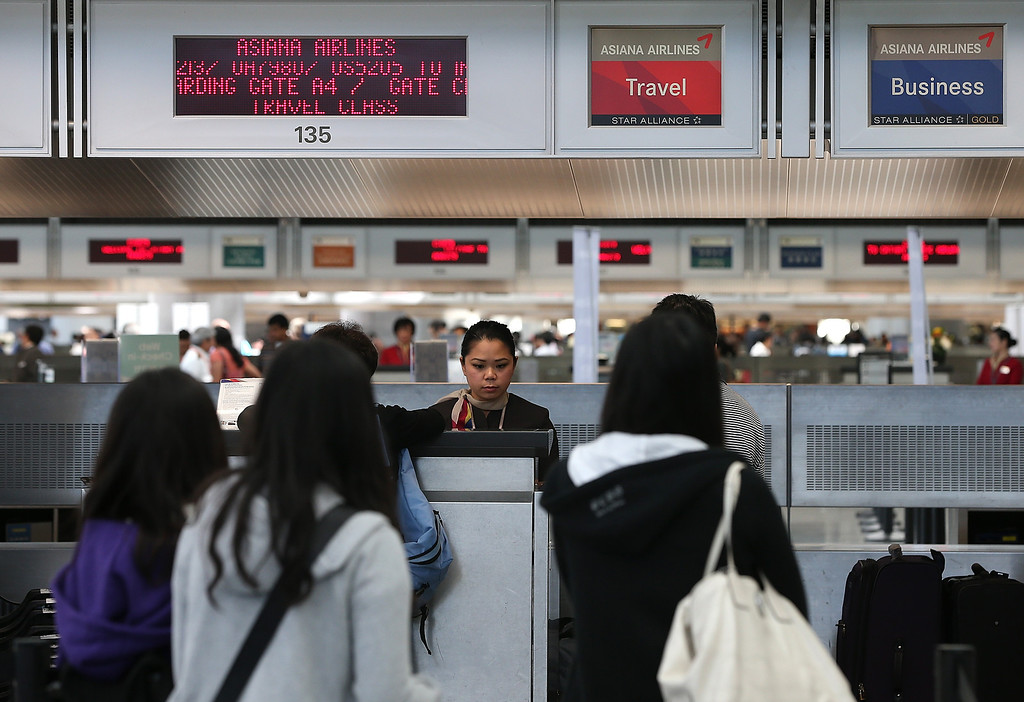 . Travelers prepare to check in for an Asiana Airlines flight to Korea in the international terminal at San Francisco International Airport on July 8, 2013, in San Francisco, Calif.  Two days after Asiana Airlines flight 214 crash landed at San Francisco International Airport, the National Transportation Safety Board is continuing their investigation as to why the plane crashed.  (Justin Sullivan/Getty Images)
