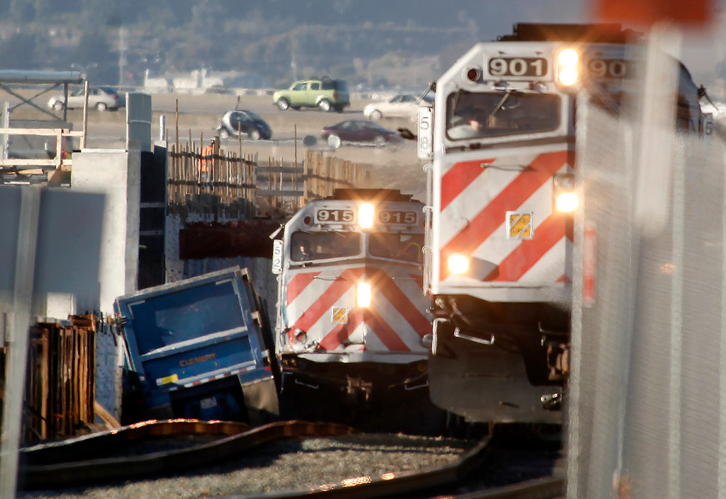 . Caltrain was forced to single track through San Bruno after an earlier southbound train struck a big rig at a construction site at Angus Avenue at 2:30 Monday afternoon Feb. 11, 2013..  (Karl Mondon/Staff)