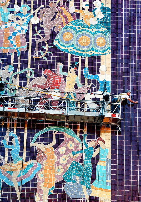 . Workers clean the facade of the Paramount Theatre in Oakland in 1997. (Mary F. Calvert/Bay Area News Group Staff Archives)