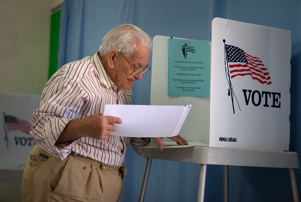 . Manuel Flores, 83, votes at the Alum Rock Christian Church in San Jose as voters cast their ballots Tuesday, July 30, 2013 in the Santa Clara County District 2 supervisor race between labor leader Cindy Chavez and rival Teresa Alvarado.  (Patrick Tehan/Bay Area News Group)