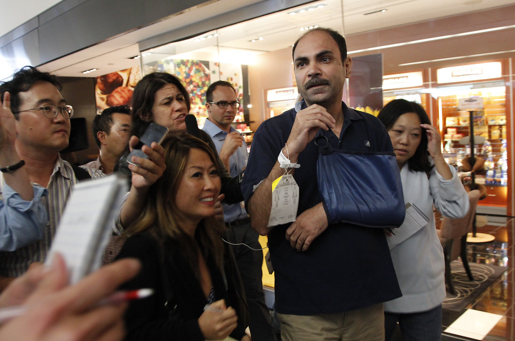 . Vedpal Singh talks to reporters after his Asiana Airlines flight 214 from Seoul Korea, crashes at San Francisco International Airport on Saturday July 6,  2013. Singh broke his collarbone and was looking for his wife when he spoke to reporters .  (LiPo Ching / Bay Area News Group)