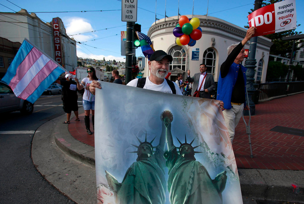 . Artist Frank Pietronigro brought his Statue of Liberty painting out to the Castro to celebrate a major Supreme Court ruling in favor of same-sex marriage Wednesday morning, June 26, 2013 in San Francisco, Calif. (Karl Mondon/Bay Area News Group)