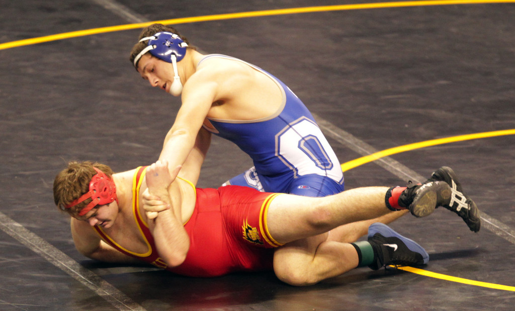 . Orland\'s Victor Raigoza, right, wrestles Oakdale\'s Zach Fallentine in a 220-pound first round match during the California Interscholastic Federation wrestling championships in Bakersfield, Calif., on Friday, March 1, 2013. Raigoza would go on to win. (Anda Chu/Staff)