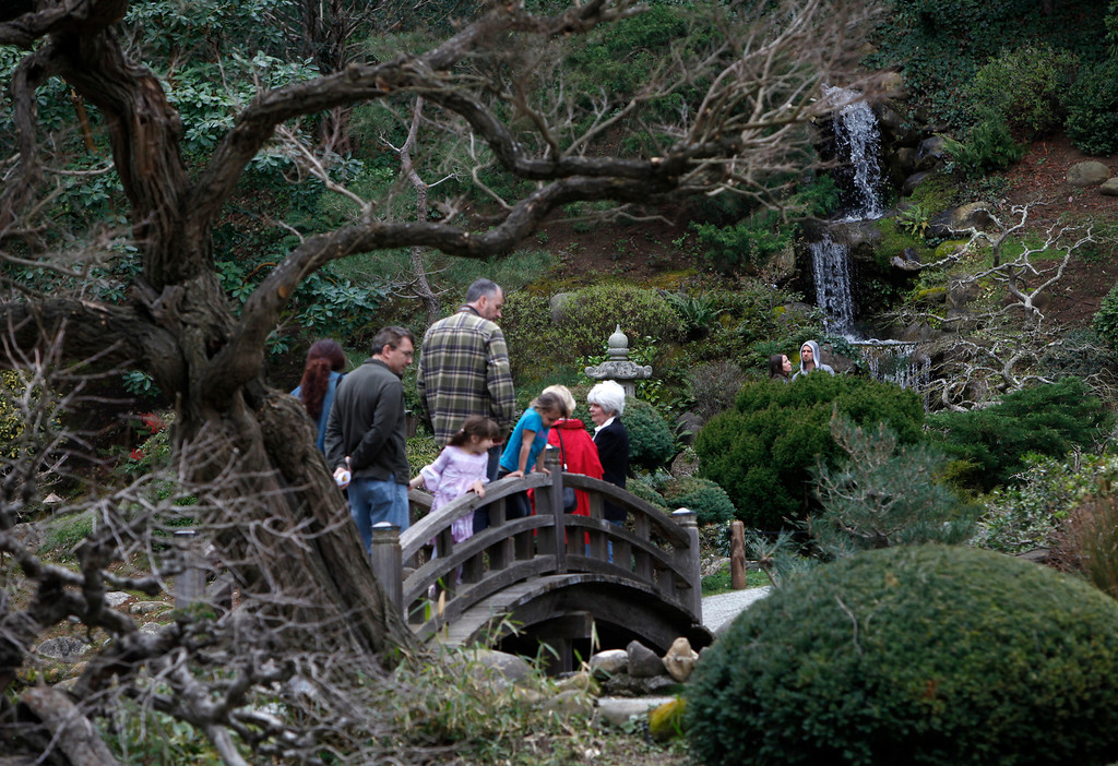 ". Visitors wander through Hakone Estate and Gardens during a Lunar New Year of the Snake festival with a ""Chinese Village Fair\"" on Sunday afternoon, March 3, 2013 in Saratoga, Calif. (Karl Mondon/Staff)"
