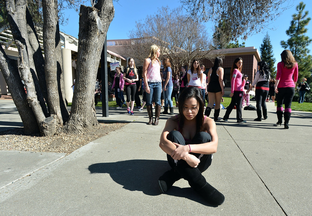 ". Women take their places as they prepare to dance on the Diablo Valley College campus during a ""One Billion Rising\"" event at the college in Pleasant Hill, Calif. on Thursday, Feb. 14, 2013. \""One Billion Rising\"" is an international event to raise awareness of sexual assault and violence against women. (Kristopher Skinner/Staff)"