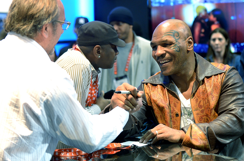 . Retired American proffessional boxer Mike Tyson signs autographs at SMS Audio booth at the 2013 International CES at the Las Vegas Convention Center on January 9, 2013 in Las Vegas, Nevada. (JOE KLAMAR/AFP/Getty Images)