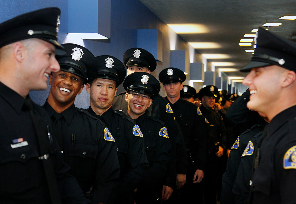 . San Jose Police Department Recruit Officers wait in the procession line at the San Jose Police Academy graduation in San Jose, Calif. on Friday, March 15, 2013.   (LiPo Ching/Staff)