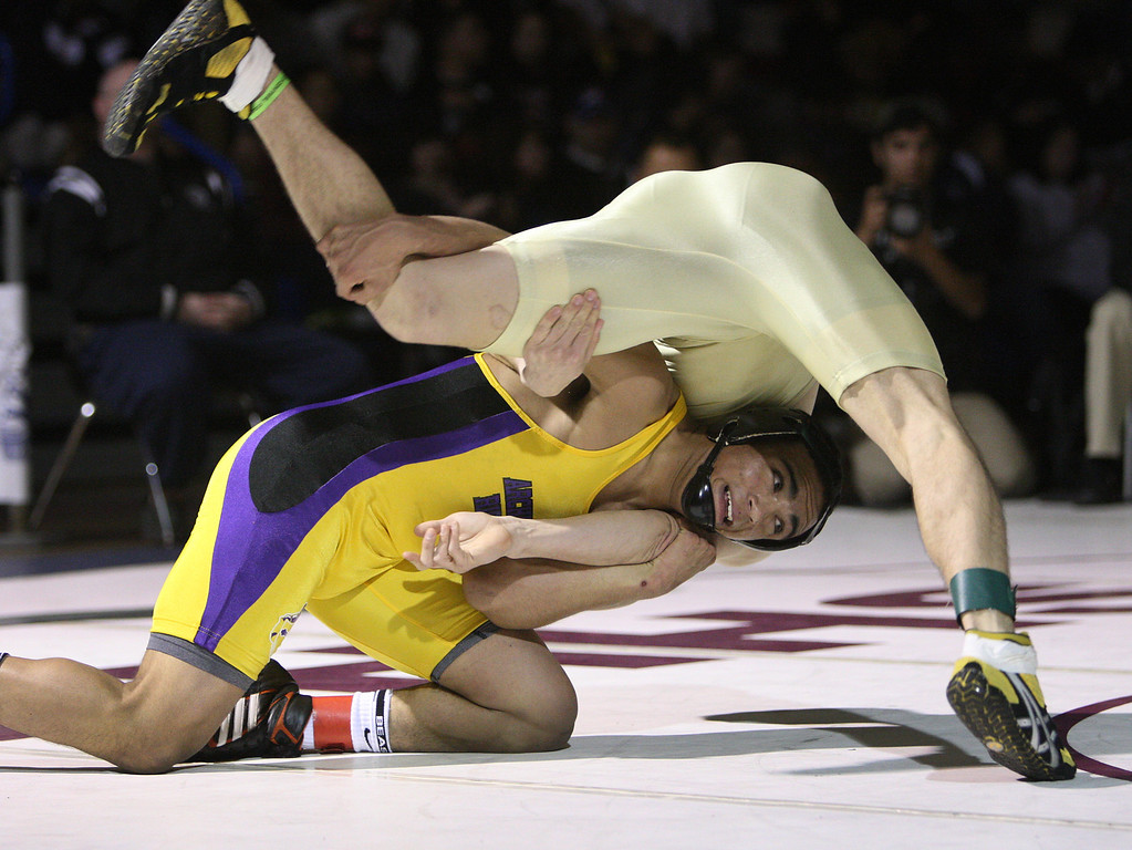 . Riodan\'s Zac Contreras flips Mitty\'s Shane Triantos in his victory in the 145 pound class during the CCS wrestling championships at Independence High School in San Jose, Calif. on Saturday, Feb. 23, 2013. (Jim Gensheimer/Staff)