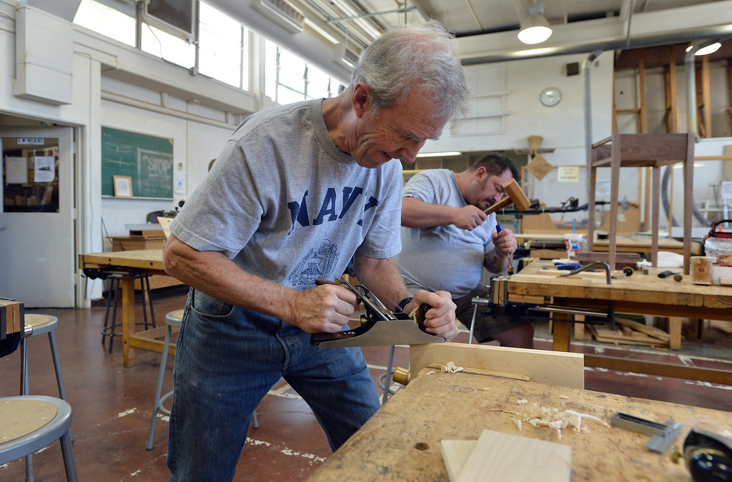 . Diablo Woodworkers instructor David Lipscomb planes a drawer piece in Pleasant Hill, Calif. on Wednesday, July 24, 2013. The Diablo Woodworkers are reaching out to military veterans and emphasizing the therapeutic qualities of woodworking. (Kristopher Skinner/Bay Area News Group)
