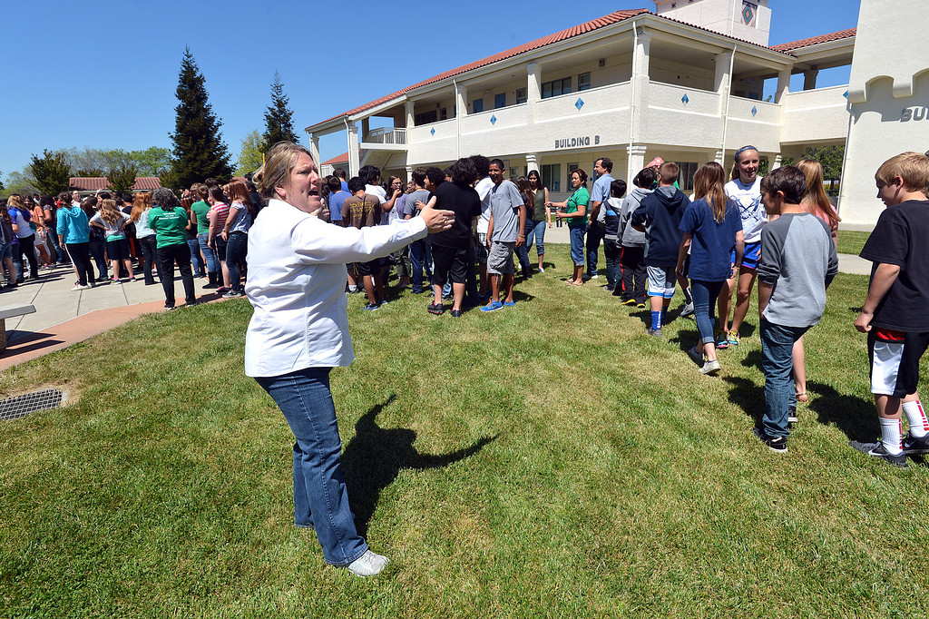 . Martinez Junior High School principal Helen Rossi, left, directs students into the center of the school where they were creating a video to send well wishes to fellow student Aaron Hern in Martinez, Calif., on Friday, April 19, 2013. Hern is recovering in Boston at Children\'s Hospital after being severely injured at the Boston Marathon explosion last Monday. (Dan Rosenstrauch/Bay Area News Group)