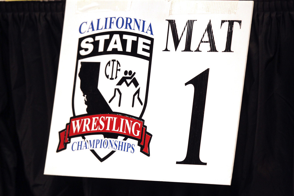 . A sign points out mat one at the California Interscholastic Federation wrestling championships in Bakersfield, Calif., on Friday, March 1, 2013. (Anda Chu/Staff)