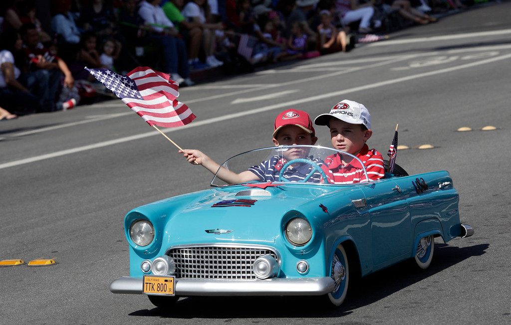 . Twins, Chase and Blake Affrunti, 6, represent the Santa Clara Valley T-Bird Club in the annual Fourth of July parade in Redwood City, Calif. on Thursday, July 4, 2013. Considered the largest Independence Day parade in Northern California, it is celebrating its 75th year. (Gary Reyes/Bay Area News Group)