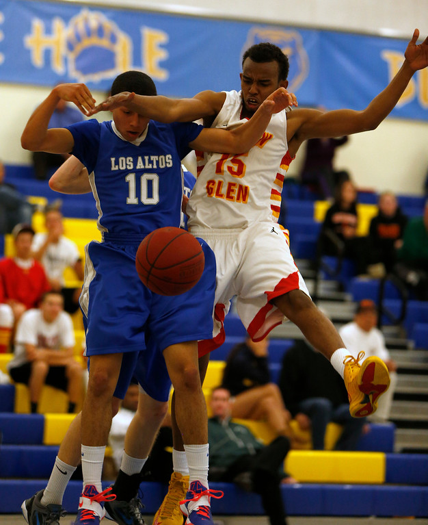 . Los Altos High School\'s Nate Vieira (10) fights for the ball against Willow Glen High School\'s Hassan Abdi (15) in the third period for the CCS Division II Boys Basketball semifinals at Santa Clara High School in Santa Clara, Calif., on Tuesday, Feb. 26, 2013.  Willow Glen High School won 59-57.  (Nhat V. Meyer/Staff)