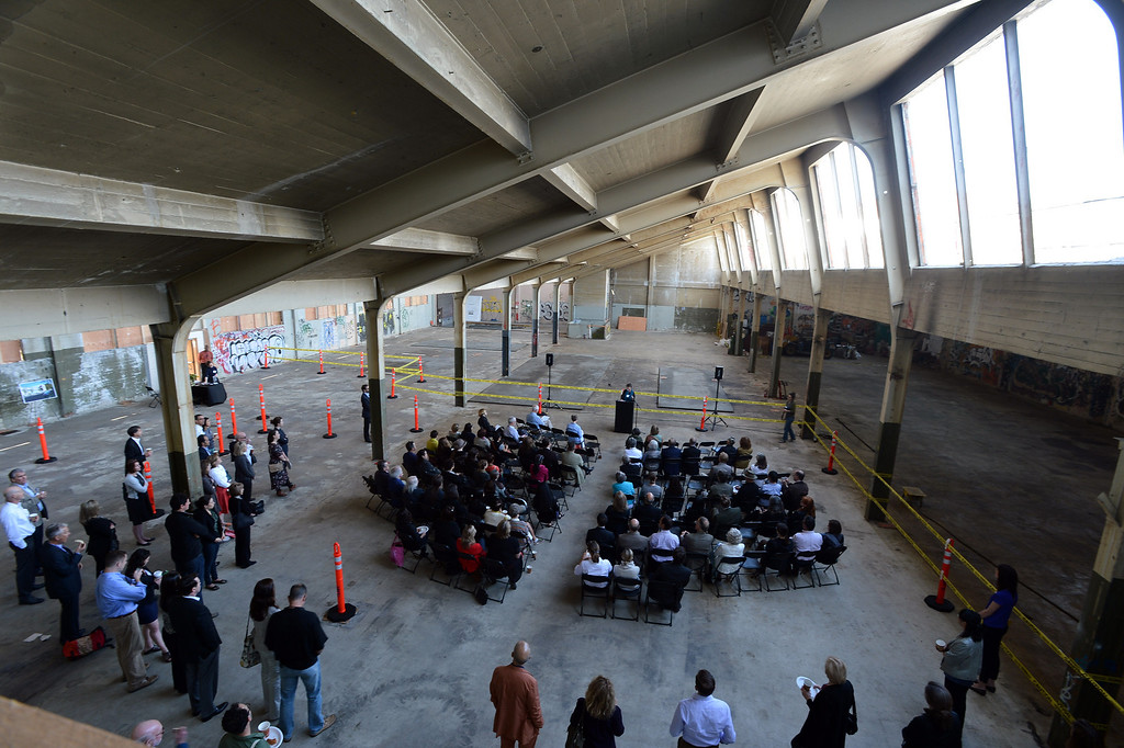 . A speaker addresses a crowd gathered to get a sneak peek at the interior of what will be part of the new Berkeley Art Museum/Pacific Film Archive in Berkeley, Calif. on Tuesday, April 30, 2013. (Kristopher Skinner/Bay Area News Group)