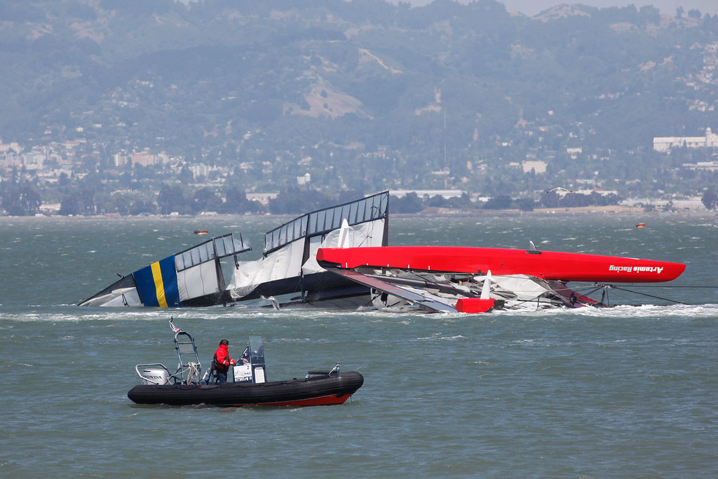 . The Artemis catamaran, Sweden\'s 72-foot America\'s Cup entry, is towed past Treasure Island after a fatal capsize in San Francisco Bay on Thursday, May 9, 2013. (Karl Mondon/Bay Area News Group)