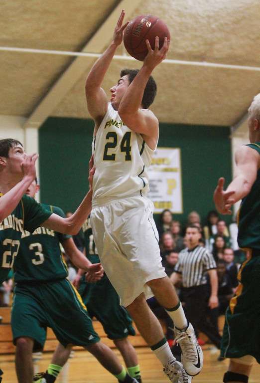 . Pinewood\'s Josh Rose goes for a layup in the first quarter during a game Head-Royce at Pinewood High School in Los Altos on Wednesday, March 6, 2013.   (Kirstina Sangsahachart/ Daily News)