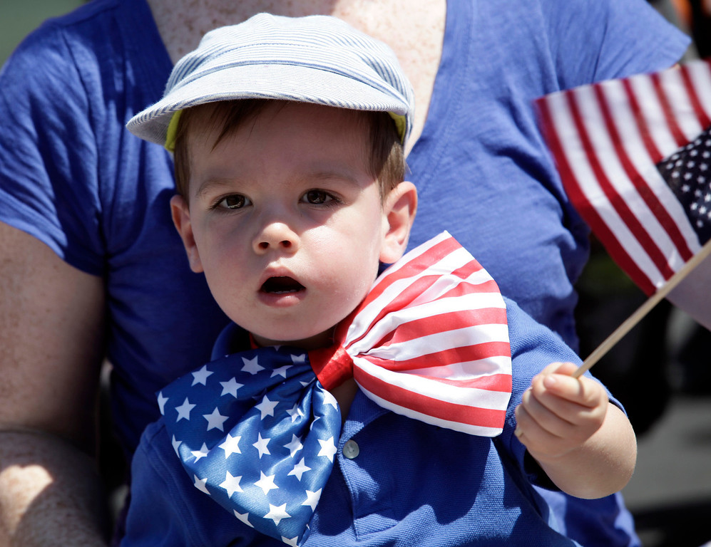 . One-year-old, Devin Gay, watches the annual Fourth of July parade along Arguello St. in Redwood City, Calif. on Thursday, July 4, 2013. Considered the largest Independence Day parade in Northern California, it is celebrating its 75th year. (Gary Reyes/Bay Area News Group)