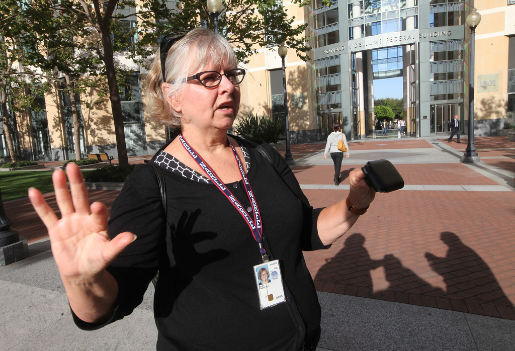 ". Francine Roby, executive director of the Federal Executive Board, calls the shutdown ""demoralizing\"" for the federal workers affected by the government shutdown on Tuesday, Oct. 1, 2013, outside the Ron Dellums Federal Building in Oakland, Calif.  The gridlock in Congress has partially shutdown the federal government allowing many federal workers half a day to prepare their offices for closure.  (Laura A. Oda/Bay Area News Group)"