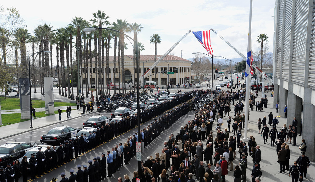 ". Law enforcement officers line up to walk in members of the Santa Cruz Police Department at the HP Pavilion in San Jose, Calif., on Thursday, March 7, 2013. Thousands are expected at the pavilion to mourn the loss of the two Santa Cruz police officers Loran ""Butch\"" Baker and Elizabeth Butler, who lost their their lives in the line of duty on Feb. 26. (Dan Honda/Bay Area News Group)"