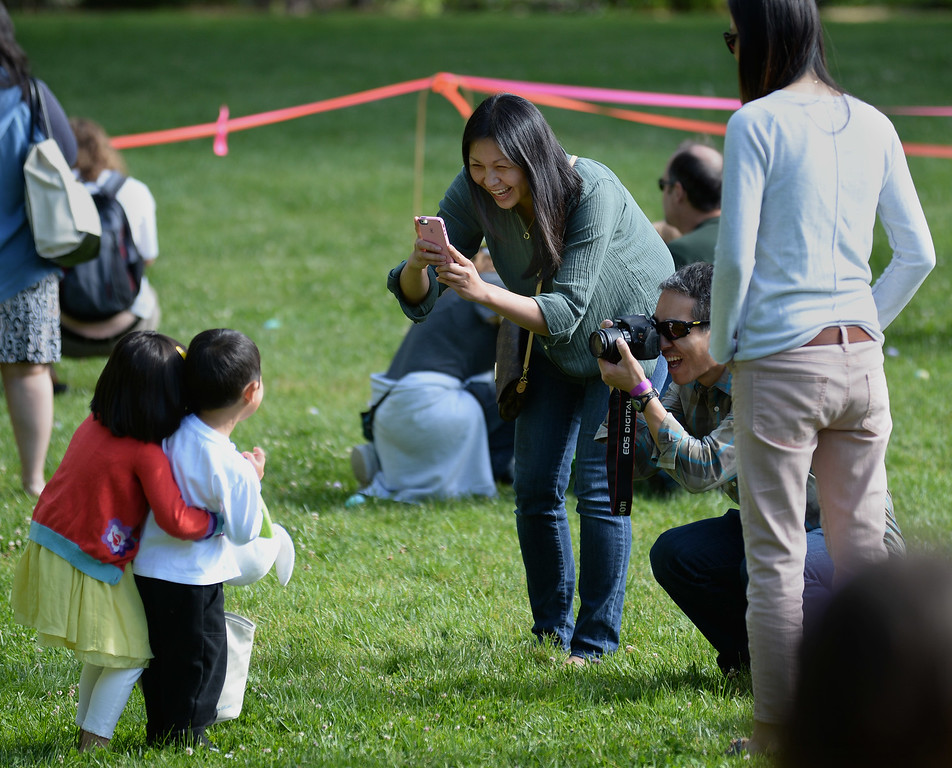 """. Kurt Yanagimachi, right, of Lafayette, and Annie Peters, left, of San Carlos, take photographs of cousins Olivia Peters, 3, and Tyler Yanagimachi,3, during the Town of Danville\'s \""""Eggstravaganza\"""" held at the Danville Community Center in Danville, Calif., on Saturday, April 12, 2014. The event featured egg hunts for children of all ages as well as fun activities and snacks. (Dan Honda/Bay Area News Group)"""