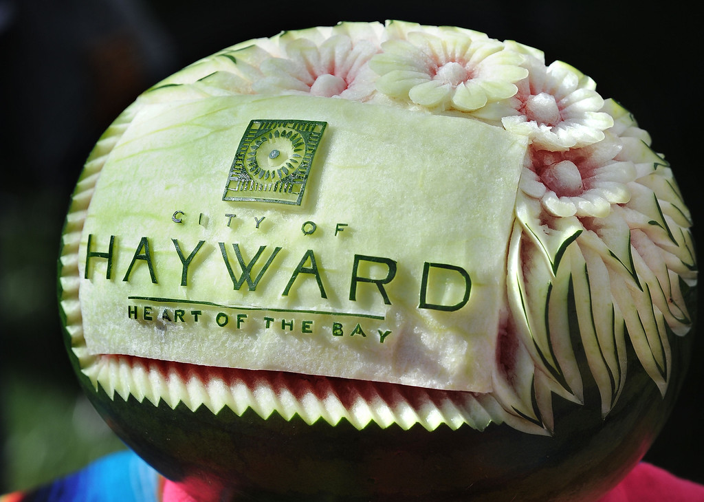 """. A decorated watermelon on distplay on the City of Haywards table during the \""""Alameda County Mayors\' Healthy Cook-Off Challenge\"""" held at the Dublin Farmers\' Market at Emerald Glen Park in Dublin, Calif., on Thursday, July 25, 2013. The Hayward team, consisting of Hayward Mayor Pro Tem Mark Salinas and Chef Tony Solorio with the Hayward\'s Tacos Uruapan restaurant, went on to place second, advancing them to compete against the winners of the Contra Cost County Mayors\' Healthy Cook-Off Challenge. The contest will be held at Mt. Diablo High School in the fall. The cook-off was presented by Concord\'s Wellness City Challenge and promotes the importance of healthy eating. (Doug Duran/Bay Area News Group)"""