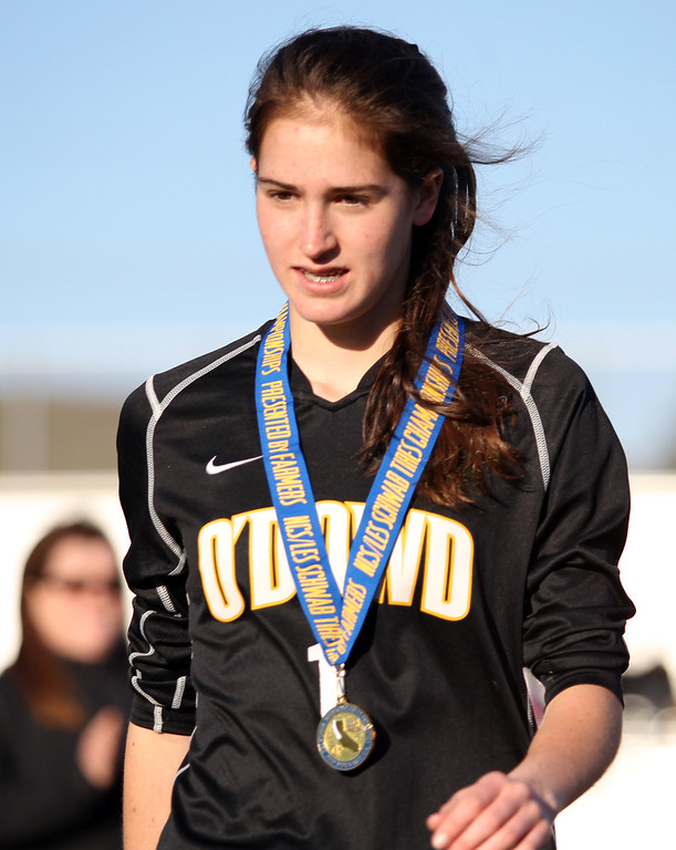. Bishop O\'Dowd goalie Lorna McElrath (1) hangs her North Coast Section Division II Girls Soccer Championship medal after defeating Piedmont in at Dublin High School soccer field in Dublin, Calif., on Saturday, Feb. 23, 2013. Bishop O\'Dowd won 3-2 in a series of penalty kicks. (Ray Chavez/Staff)