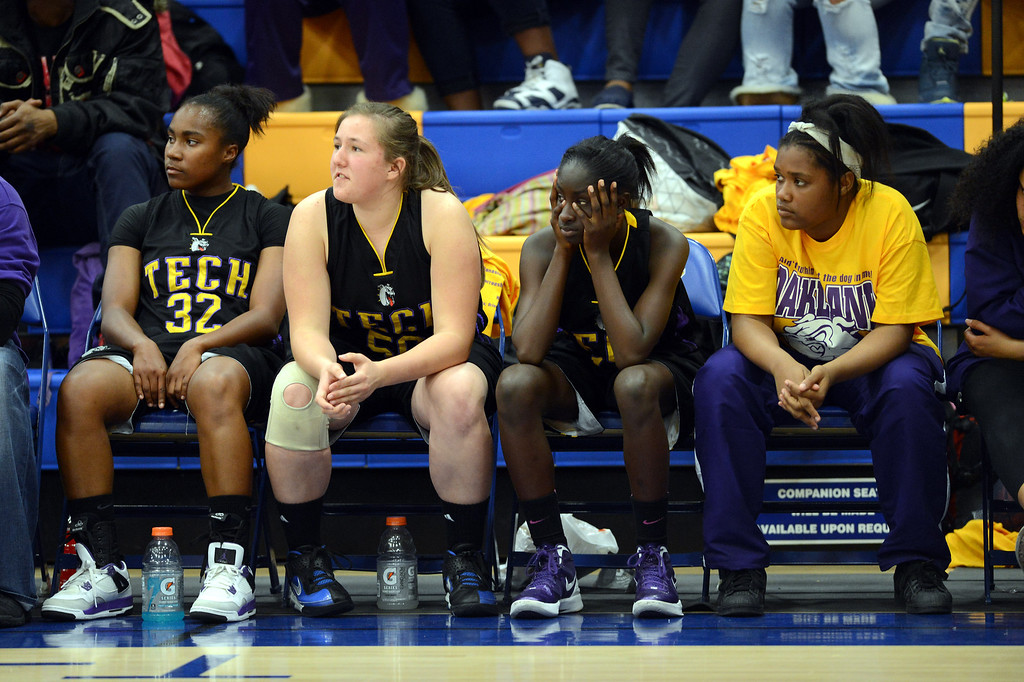 . Oakland Tech High\'s Alaysia Clemons (11) sits with head in her hands as she watches her team battle MyClymonds High in their Oakland Section high school girls basketball championship game played at Merritt College in Oakland, Calif. on Thursday, Feb. 28, 2013. (Dan Honda/Staff)
