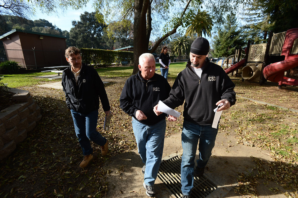 . Crockett Community Services District General Manager Dale McDonald, right, looks at some paperwork with district employee Ron Wilson as they walk through Alexander Park in Crockett , Calif. on Tuesday, Jan. 15, 2013. (Kristopher Skinner/Staff)