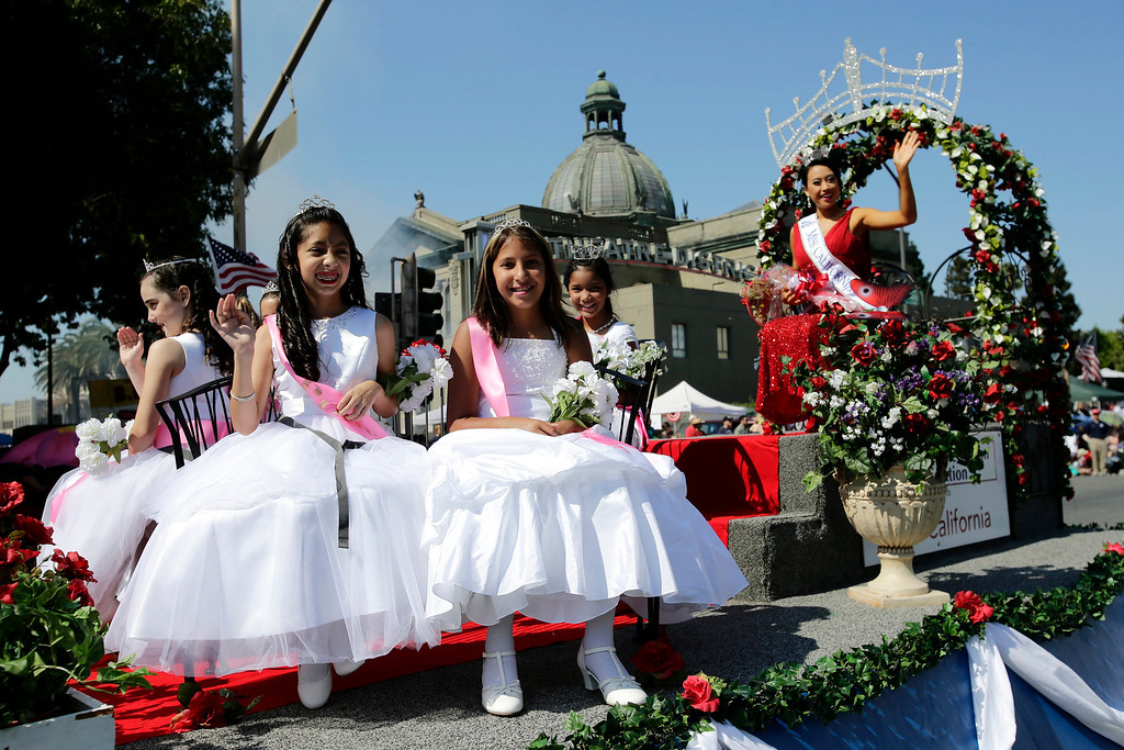 . The float carrying Miss California, Crystal Lee, passes old city hall during the annual Fourth of July parade in Redwood City, Calif. on Thursday, July 4, 2013. Considered the largest Independence Day parade in Northern California, it is celebrating its 75th year. (Gary Reyes/Bay Area News Group)