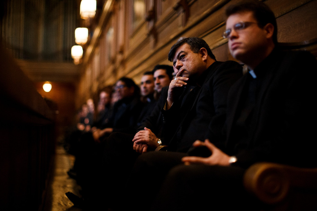 . Leonard Marrujo, second from right, a deacon with the Diocese of Oakland listens with other seminarians and faculty members of St. Patrick\'s Seminary & University during Cardinal William Levada\'s press conference to answer questions about the upcoming Conclave of Cardinals to elect a new Pope after the unexpected retirement of Pope Benedict XVI, on Feb. 25, 2013 at St. Patrick\'s Seminary & University in Menlo Park. (Dai Sugano/Staff)