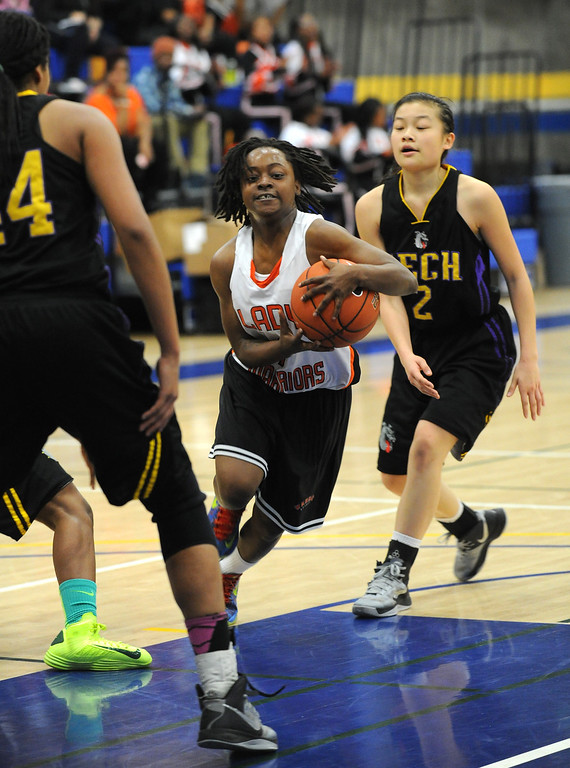 . McClymonds High\'s Gabby Gaines (1) drives to the basket against Oakland Tech High in their Oakland Section high school girls basketball championship game played at Merritt College in Oakland, Calif. on Thursday, Feb. 28, 2013. (Dan Honda/Staff)