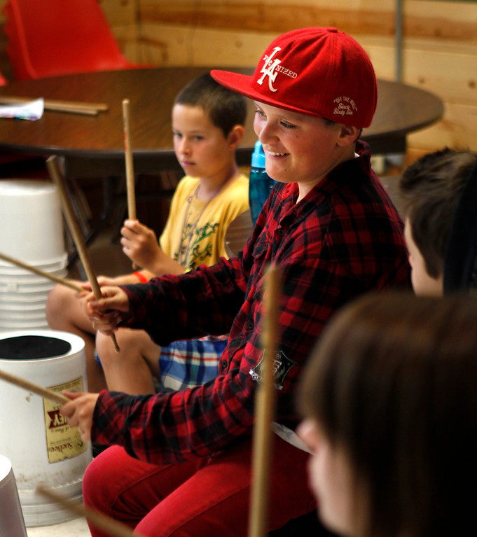 . Marcus Cathcart, 10, left, and Alex Rodriguez, 12, both of Atascadero, participate in a drum circle during Camp ALWAYS at Mt. Cross in Ben Lomond, Calif., on Tuesday, June, 25, 2013.  (Patrick Tehan/Bay Area News Group)