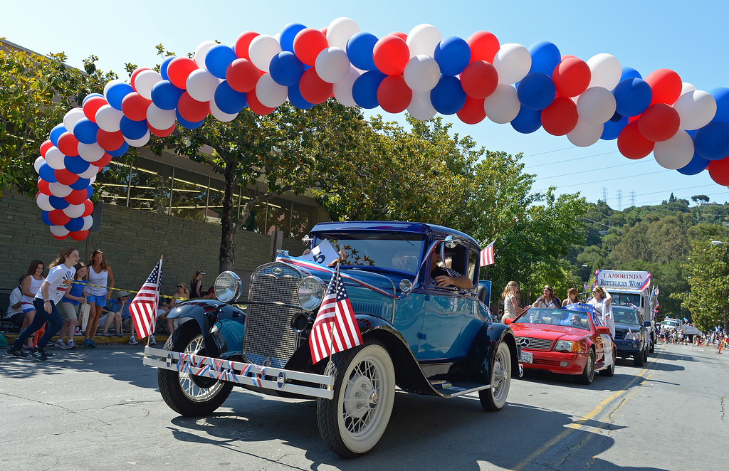 . Don Carter, of Lafayette, drives his 1931 Ford model A car in the 30th anniversary Lamorinda Fourth of July parade and celebration on Thursday, July 4, 2013. (Jose Carlos Fajardo/Bay Area News Group)