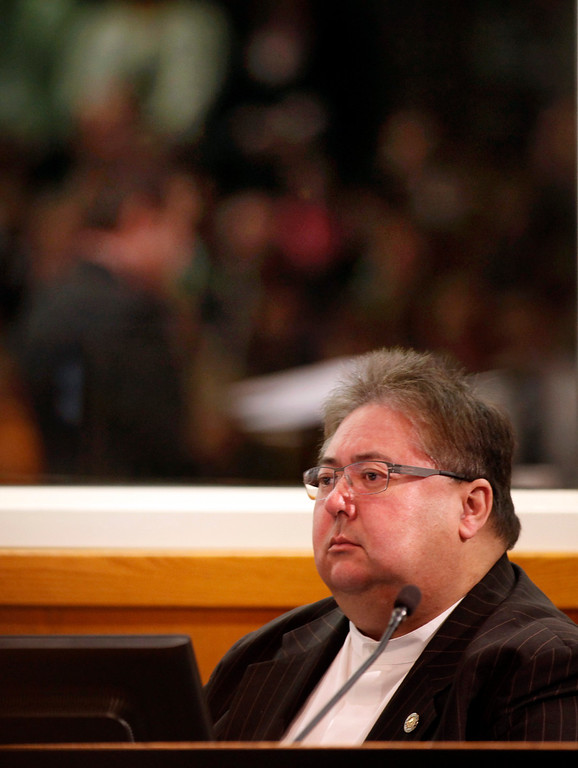 . Supervisor George Shirikawa, Jr., past president of the County of Santa Clara Board of Supervisors, listens to the new board president, Ken Yeager (reflected in the mirror) deliver the 2013 State of the County Address in the Board Chambers on Tuesday Jan. 29, 2013 in San Jose, Calif. (Karl Mondon/Staff)