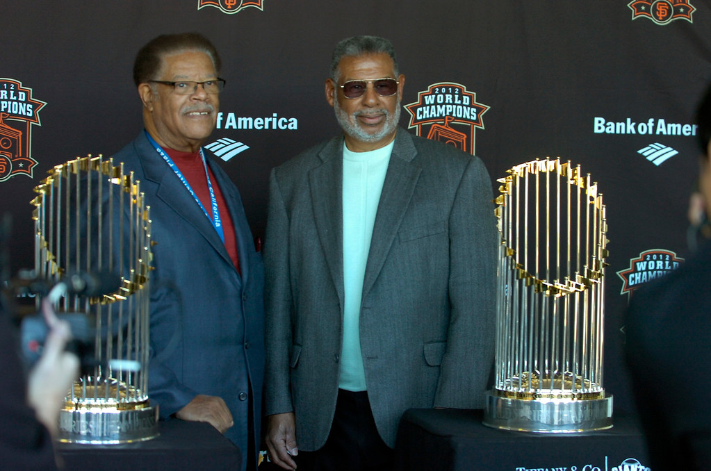 . Richmond City Council members Nat Bates, left, and Corky Boozé pose with the World Series Trophy as it makes a stop at the Richmond Memorial Auditorium in Richmond, Calif. on Monday, Jan. 14, 2013.  (Kristopher Skinner/Staff)